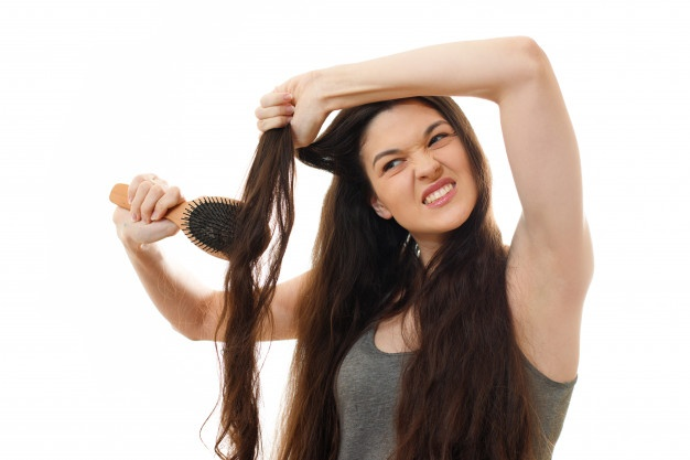 Woman struggling with her hair