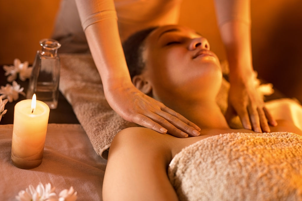 Seek Faster Relief - Close-up of African American woman relaxing at the spa during shoulder massage.