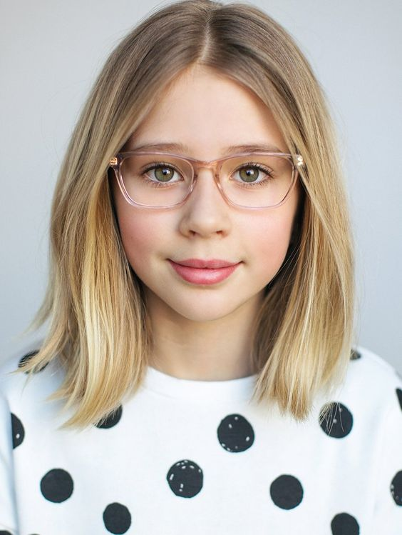 An 11 Year Old girl with Bob Haircut wearing specs